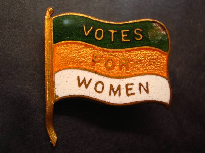 Photograph of an early 20th century British Women's Suffrage lapel pin,