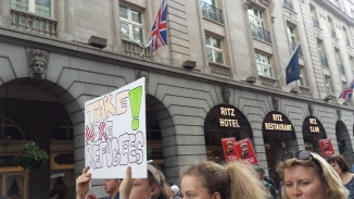 'Take More Refugees' sign at demonstration next to the Ritz Hotel. Photograph by Hannah Jones.